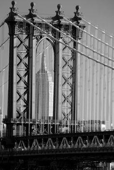 Empire State through Manhattan Bridge    Taken from the Brooklyn Bridge looking through the Manhattan Bridge towards the Empire State.  By david.nikonvscanon David Blaikie