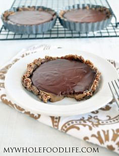 These delicious Salted Caramel Chocolate Tarts look fancy, but they are easy to make. Vegan, gluten free and grain free. Nut free option too.