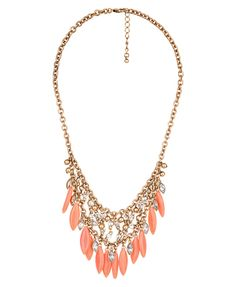 love the peach in the necklace