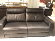 Motorized sofa    Oh so comfy and contrast stitching