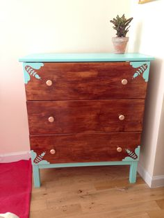 DIY Ikea Tarva dresser. Ikea hack, stained walnut color with aqua accents and gold painted knobs.