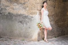 Everything just undeniably fell into place. The makeup, the shoes, the wedding dress and her bubbly personality just sent the sun smiling down at her. Totally love her pose on this shot. Do you?