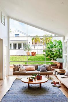 A colourful coastal cottage in Byron Bay | real living Modern Family, Home And Family, Family Room, Real Living Magazine, Making Barn Doors, Custom Shelving, Oak Shelves, All White Kitchen, Coastal Cottage