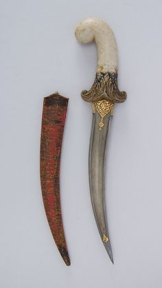 Dagger (Jambiya) with Sheath. Date: 19th century. Culture: Indian. Medium: Steel, marble, silk, gold, wood, silver. © 2000–2014 The Metropolitan Museum of Art.