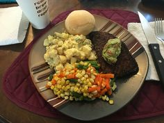 Medium Rare sirloin with carne asada  seasoning and guacamole. Mixed Veg Finished off the tater salad Dinner roll