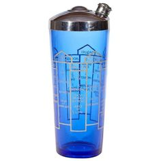 Vintage Art Deco style cobalt glass recipe shaker with a chrome lid. The shaker has different cocktails with recipes to make the drinks. Cobalt Glass, Cobalt Blue, Cocktail Accessories, Blue Cocktails, Art Deco Era, Cocktail Shaker, Art Deco Fashion, Antique Furniture, Vintage Items
