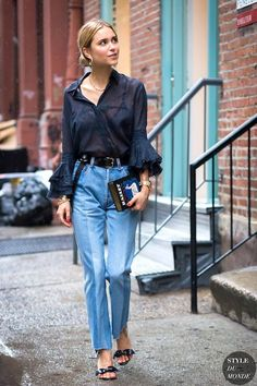 Photos via: Style Du Monde Pernille Teisbaek is looking gorgeous as ever in a low bun, ruffle cuff blouse, reconstructed Vetements jeans and sandals. Her unique Olympia Le Tan embroidered clutch impec