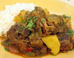 Curry goat with rice and peas. Sooo delicious. Curry goat recipes: http://www.bbcgoodfood.com/recipes/2369636/goat-curry http://www.caribbeanchoice.com/recipes/recipe.asp?recipe=95# http://www.mts.net/~emanuel1/shopping/recipe1.htm