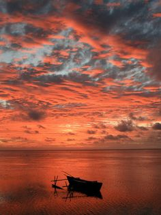 A sunset over Aitutaki, a South Pacific island.  Great website for cloud lovers http://cloudappreciationsociety.org