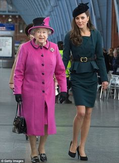 Statement pink: Queen Elizabeth wears one of her favourite colours, bright pink, as she and the Duchess of Cambridge arrive at St Pancras station, before boarding a train to visit the city of Leicester together in 2012