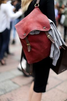 Faded red leather bag.