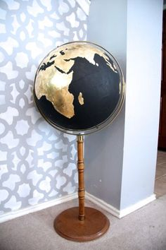 DIY Black & Gold Globe « Love & Renovations. Would love to find an old globe for this project!