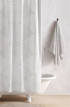 Inspired by Japanese rock gardens and hand-embroidered textiles, this sweeping shower curtain is stitched in a striking wave-like pattern.