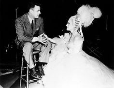 Norma Shearer visits her brother, sound pioneer Douglas Shearer, on the set of Marie Antoinette