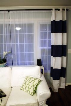 Step-by-step instructions for making your own striped drapery panels using acrylic paint.