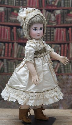 Very beautiful French Bisque Bebe Phenix by Jules Steiner Successors in wonderful antique silk dress and bonnet!  Bisque socket head, dark blue glass