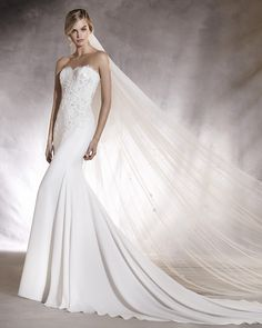 4c90137dd8e0 Pronovias Alicia.Beautiful crepe and lace fit and flare wedding dress from  Pronovias. Strapless