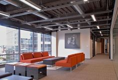 Sterling Living Room With Modern Drop Ceiling Combined Industrial Ceiling Design Also Fluorescent Lamps Support And Lined Glass Wall Featuring Orange Couch Including Artistic Painting Ideas. Best Modern Drop Ceiling At Living Space Ideas. Industrial Home Offices, Industrial Interior Design, Industrial House, Office Interior Design, Office Interiors, Office Designs, Office Ceiling, Open Ceiling, Ceiling Light Design
