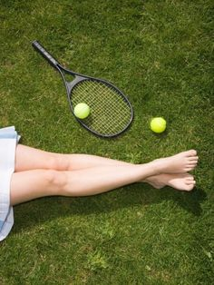 Legs of Woman and Tennis Racket