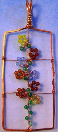 Trellis pendant -- Hammered copper frame with gemstone beaded flowers.