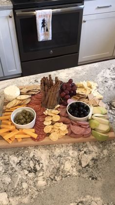 Getting Fancy with Charcuterie – The Chic(ish) Chick Charcuterie board // meat and cheese board // party food // potluck staples // party board // cheese // cheese board //