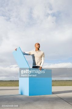 Stock Photo : Man standing in large blue open box