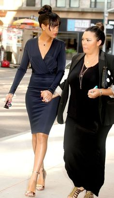 Rihanna is beautiful but so is the curvy woman she's holding hands with. Is that her mom or family?