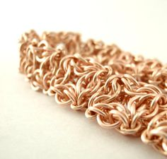 Celtic Labyrinth Chainmail Bracelet in Rose Gold features a truly unique geometric pattern!