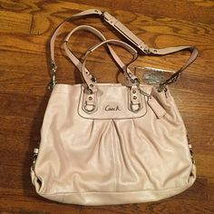 Coach Purse! With shoulder strap Gorgeous light pink leather Coach purse. This is an adorable bag! Very roomy on the inside. It is a light pink color with silver hardware and is gray on the inside. Only carried a few times! Approximately 16 inches across and 10 inches high, it really is the perfect size for a shoulder bag! Coach Bags Shoulder Bags