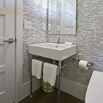HGTV - bathrooms - powder room, modern toilet, washstand sink, chrome based washstand sink with towel rail, contemporary washstand sink, hardwood floors, hickory hardwood floors, hickory floors, gray mosaic tile, stone and mosaic glass-blend tile, mosaic glass-blend tile, gray mosaic tiled walls, gray mosaic tiled powder room, polished chrome faucet, floating vanity mirror, floating bathroom mirror, white and gray tile.