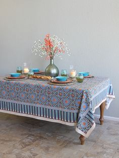 Moroccan Tile Print Blue TABLECLOTH: Smooth the soft cotton of this artisan made cloth across your table, and you'll find yourself dreaming of all the glamour of Morocco. Dinner atop this brilliant beauty will be a truly exotic affair when you serve dinner in a Tagine, and plate it on glazed ceramic tableware in chocolate, turquoise or melon.