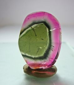 The watermelon tourmaline is a rare variety that displays three different colors green (the skin of the watermelon), pink (the sweet fruit) and white (the rind). As in the gem stone ametrine, the colors of the watermelon tourmaline occur 100% naturally. This is a rare occurence in nature.   Attract love  Balance the male and female energies within yourself  Remove imbalances (and guilt) caused by conflicts and confusions  The green part feeds your life force, while the pink soothes and harmon...