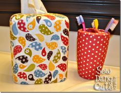 not in love with the fabric, but I like the concept of modge podging fabric to a toothbrush holder.