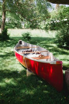 The bride's father found this canoe on Kijiji, fixed it & painted it to serve as a beverage bar. Photos by Nicole Payzant. Read more...@intimateweddings.com #diy #realwedding