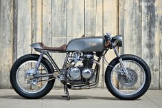 Gorgeous Honda CB550 cafe racer built by Kott Motorcycles. Love that golden grey finish.