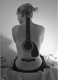 guitar tattoo on girls back | ... guitar tattoo on her back to demonstrate her love for guitar. The