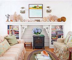 A mantel full of beachcombing treasures and bookshelves leisurely stocked for a lazy day set the mood for this laid-back cottage living room, where casually slipcovered furniture invites relaxation./