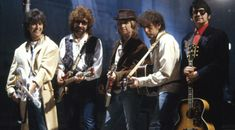 """The Traveling Wilburys, from GeorgeHarrison.com, as featured in the Traveling Wilburys portfolio.""""I hope there will be another Traveling Wilburys record. It was one of the most enjoyable things I've done. I was doing it with people I admired and respected and it turned out that the public liked it too. I just have to wait for all the other Wilburys to finish being solo artists. They have all said they would like to do it again. I don't really have a desire to be a solo artist. ..."""