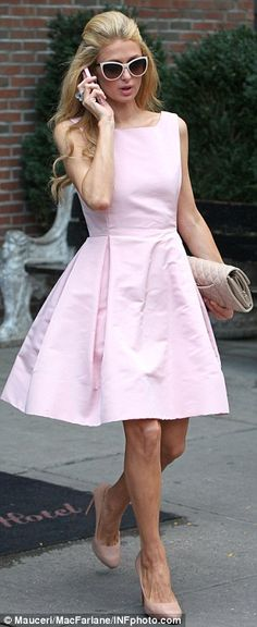 Retro: The blonde beauty paired her Fifties-inspired frock with matching cat-eye sunglasse...