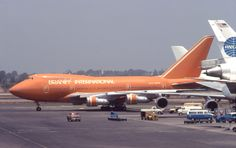 Braniff 747SP nosing out from behind a Pan Am DC-10 at Los Angeles International Airport.