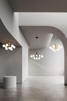 NUURA APIALES 9 CHANDELIER Pendant - Modern Scandinavian lighting is exemplified in Danish brand Nuura's clean but soft forms. The Apiales 9 Chandelier, designed by Sofie Refer, has nine bulbs and a sleek design that somehow still feels soft thanks to its inspiration: a bouquet of flowers.