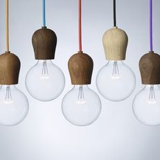 Scandi  A simple timber cap for your lightbulb from Nordic Tales of Denmark. Available in three timber finishes; Soaped Oak (light), Oiled Oak (Med) and Smoked Oak (Dark) with braided cable.  Cable colours: Red, Green, Black, Yellow, Blue, Black, Black / White zig-zag   max 60w E27 Lamp