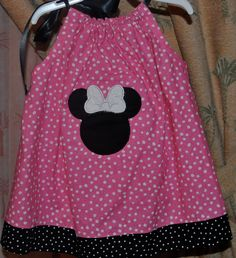 Going to Disney.  Might have to purchase a couple of these :-).  Pink Mouse Polka Dot Pillowcase Dress. $20.00, via Etsy.