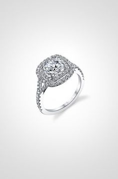 This platinum engagement ring's double halo, like the one on Jessica Biel's engagement ring, is designed by Sylvie.
