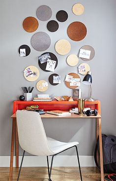 Cork and stain do double duty in a work space with cork rounds that act as whimsical artwork and mini bulletin boards for notes and photos. Stain and spray paint provide color while varying sizes of cork add a sense of movement.