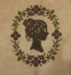 another cross stitch cameo lady on tea dyed 28 ct lugana stitched over one.