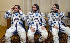 Expedition 33/34 crew members, NASA Astronaut and Flight Engineer Kevin Ford, left, Russian Cosmonaut and Soyuz Commander Oleg Novitskiy, and Russian Cosmonaut and Flight Engineer Evgeny Tarelkin, right, talk with colleagues shortly after having had their Russian Sokol suits pressure checked ahead of their launch onboard a Soyuz TMA-06M spacecraft to the International Space Station, Tuesday, October 23, 2012, in Baikonur, Kazakhstan.