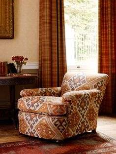 Kilim Upholstery Fabric Heavy weight upholstery fabric in the style of a turkish rug, in brown, plum, terracotta and yellows Weird Furniture, Green Lounge, Cheap Chairs, Country House Interior, Interiors Magazine, High Back Chairs, Chair Fabric, Upholstery Fabrics, House Rooms