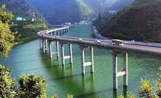 The Bridge Built In The Middle Of A River Valley. Hubei, China.
