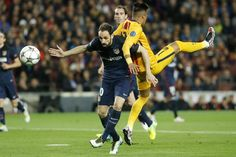 Atletico Madrid's defender Juanfran (L) vies with Barcelona's Brazilian forward Neymar during the UEFA Champions League quarter finals first leg football match FC Barcelona vs Atletico de Madrid at the Camp Nou stadium in Barcelona on April 5, 2016.